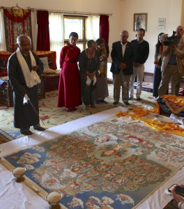 Mr. Rongae presenting the thangka