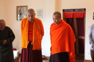 The Sakyong and H.E. Namkha Drimed Rinpoche viewing the thangka