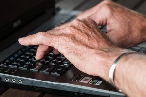 elder hands on keyboard